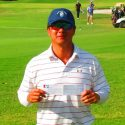 Golf pro Sunny Kim holds up scorecard