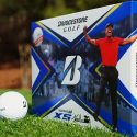 The new Bridgestone Tour B XS Tiger Woods Edition golf ball package on grass