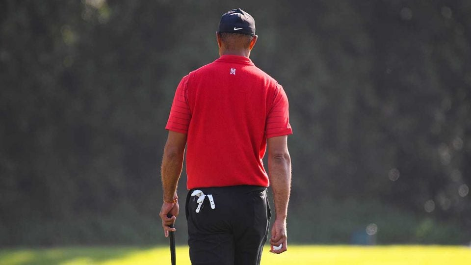 Tiger Woods walks off a green during the final round of the Genesis Invitational last month.