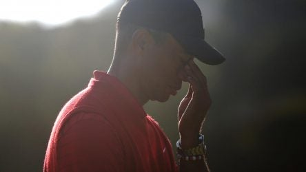Tiger Woods grabs bridge of nose with his fingers