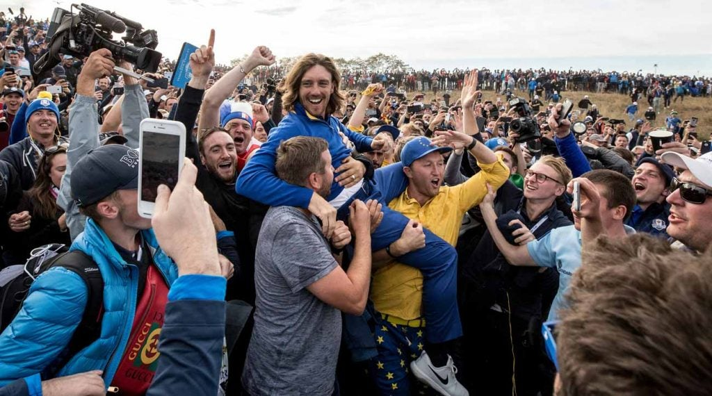 Fans carry pro Tommy Fleetwood after Europe's victory at the 2018 Ryder Cup.
