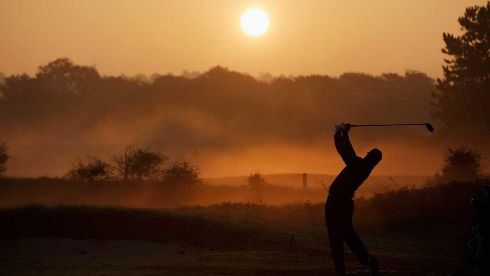 Pro golfer teeing off