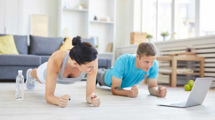 man and woman working out at home