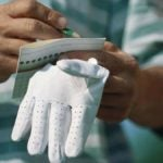 Golfer write on scorecard