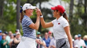 two golfers high five