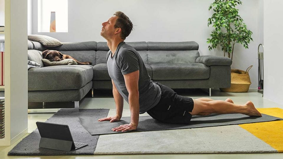 Man using a fitness app at home.