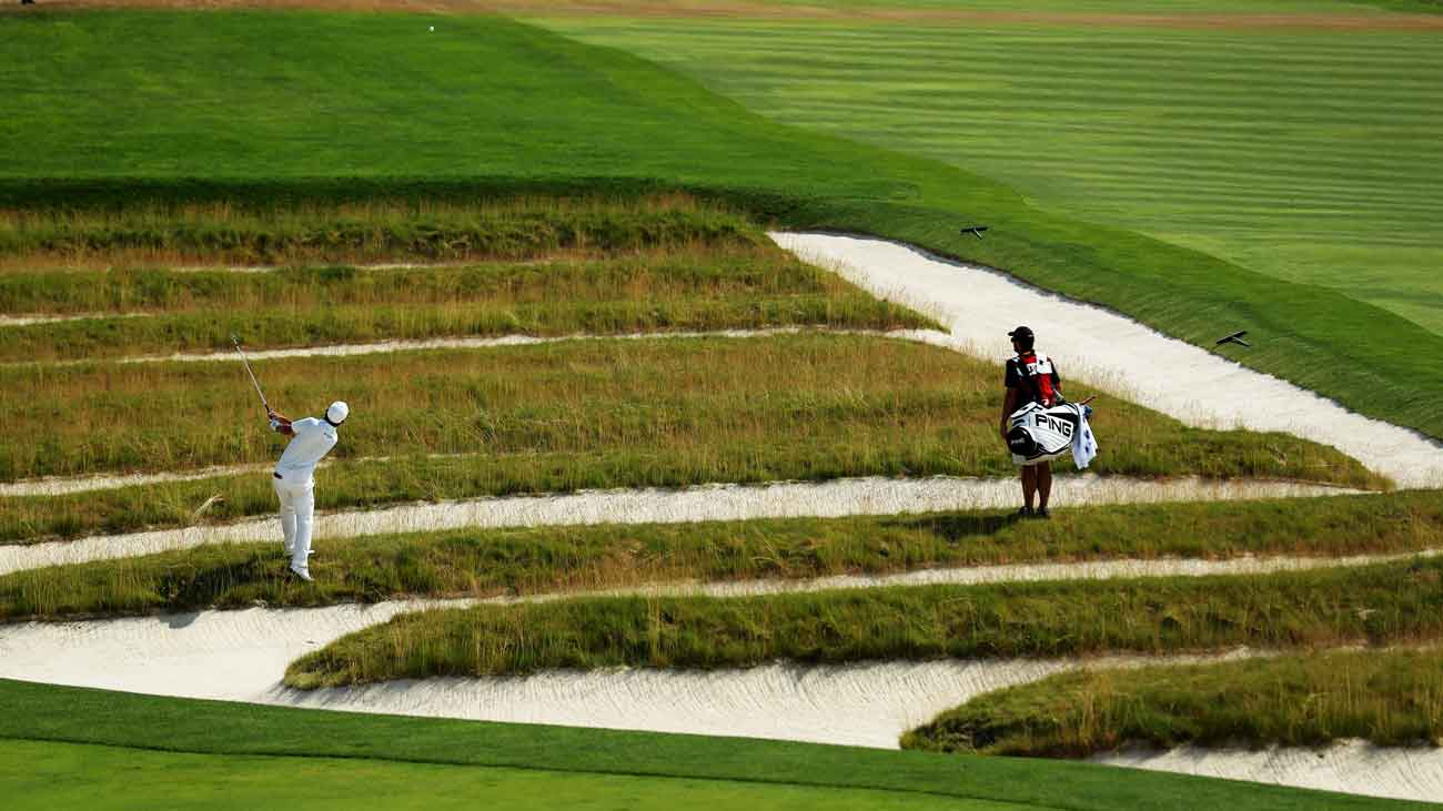 Andrew Landry plays a shot from the church pew bunkers on the 609-yard, par-5 fourth hole during the 2016 U.S. Open.