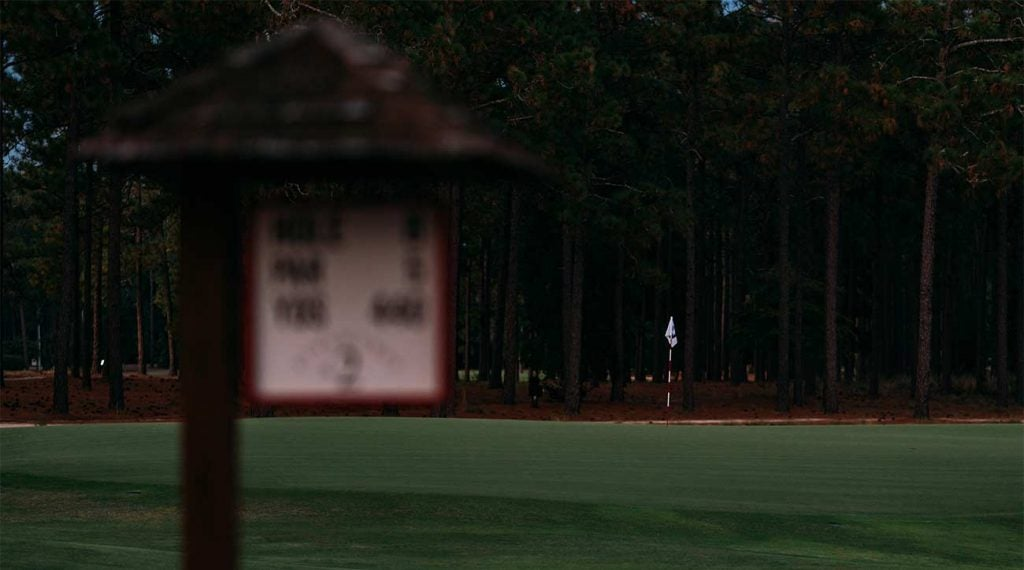A tee box sign and green at Pinehurst No. 2.