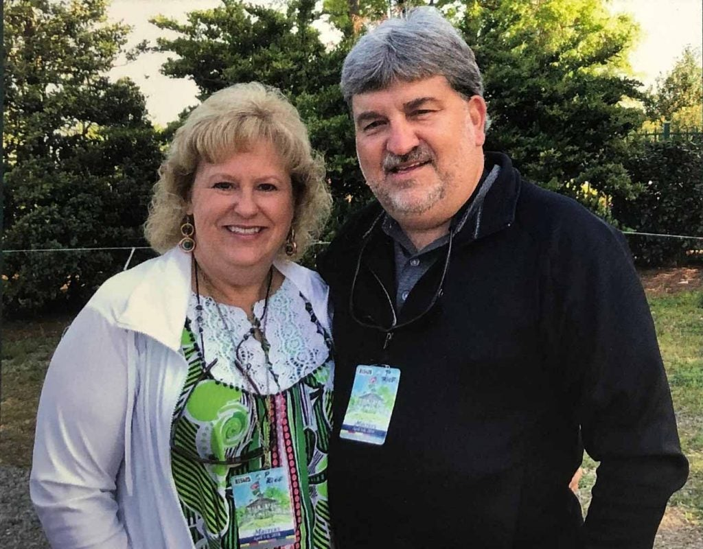 Johnny Pruitt and his wife Christine wearing their Masters badges on Friday in 2018.