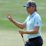 Bernhard Langer waves to the crowd.
