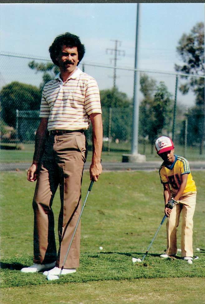 Rudy Duran (left) with a young Tiger Woods.
