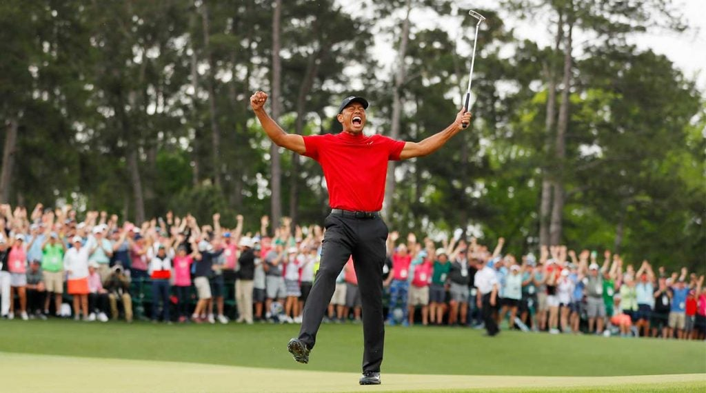 Tiger Woods celebrates his fifth Masters victory on the 18th green at Augusta National.