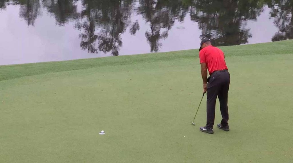 That putt on No. 12 stayed up — barely — and Woods was suddenly tied for the lead.
