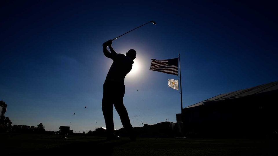 Golfer tee shot american flag
