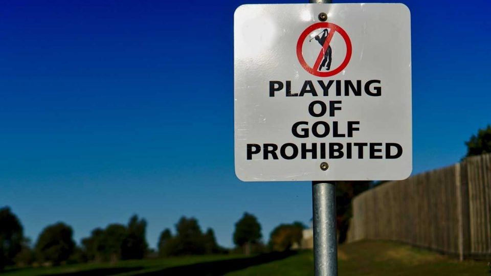 A sign prohibiting the playing of golf.
