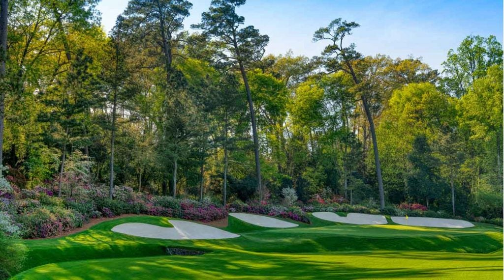 The 13th green, with azaleas in full bloom in the background. In 2010, Phil Mickelson hit one of the tournament's best-ever shots here, knocking his second shot, from the pinestraw right of the fairway, to within about 5 feet.