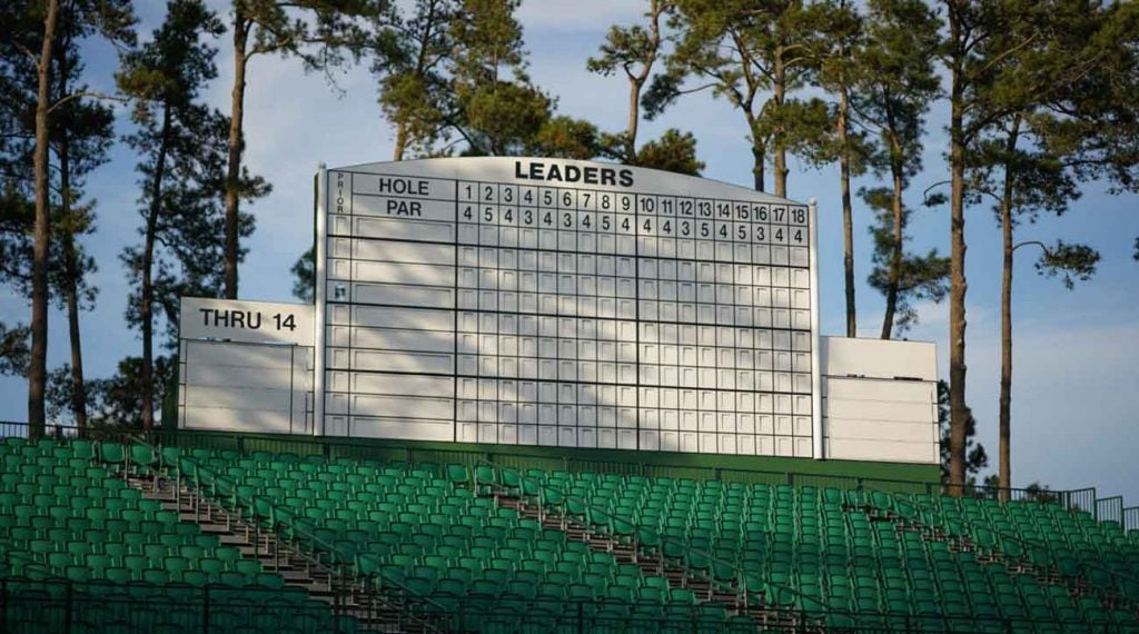 """The scoreboard overlooking the par-5 15th. No names, no numbers. In 1935, Gene Sarazen holed a 4-wood from 235 yards out for a double eagle here, his """"shot heard 'round the world."""" In 2019, Woods took the lead here and never let go."""