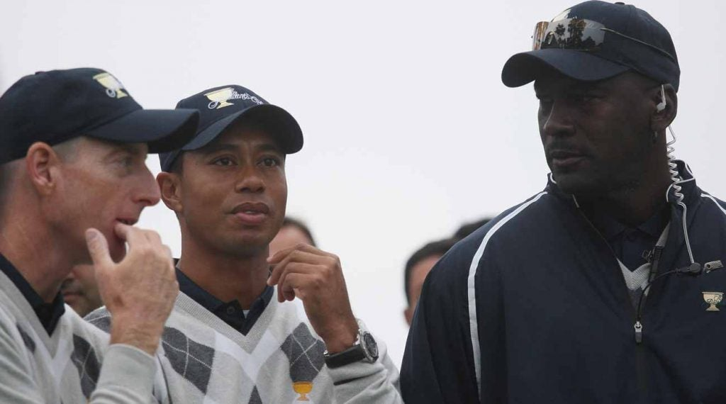 Jim Furyk stands with Woods and Jordan at the 2009 Presidents Cup at Harding Park.
