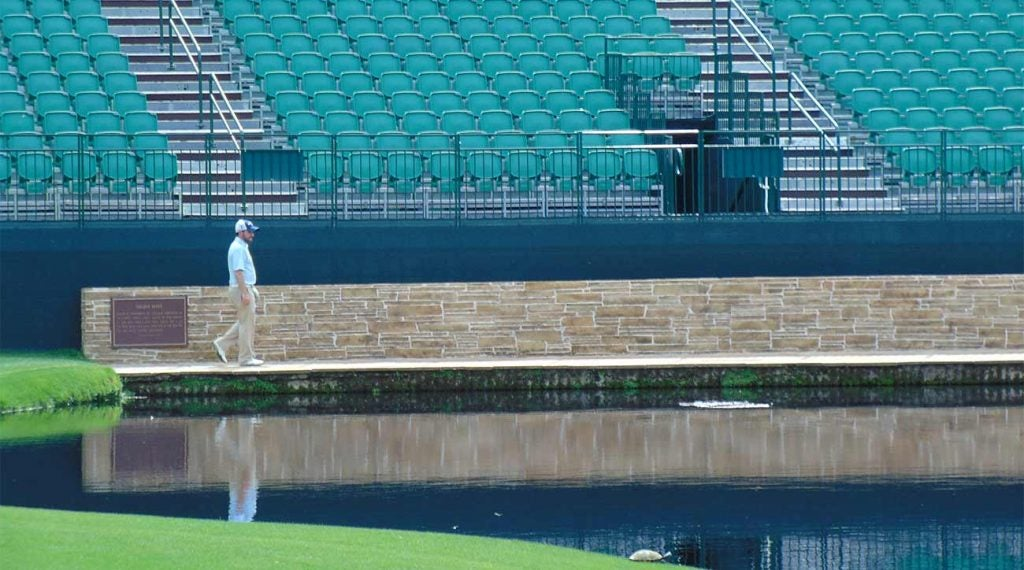 Ryan Asselta walks across the Sarazen Bridge to the 15th green.