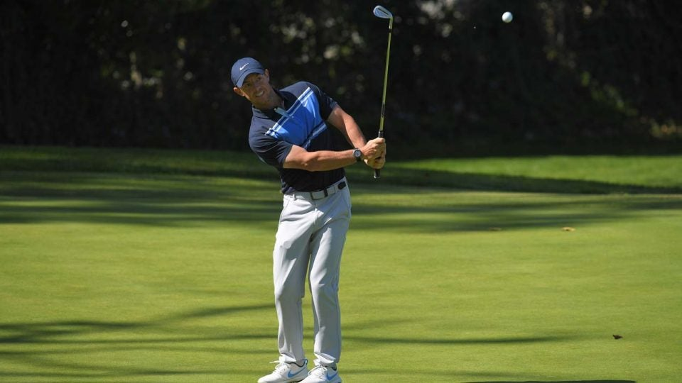 rory mcilroy hits a chip shot