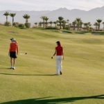 Golfers social distancing on the golf course.