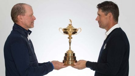 Steve Stricker and Padraig Harrington hold the Ryder Cup.