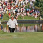 Mark Calcavecchia and Tiger Woods walk onto a green at the 2007 Tour Championship.