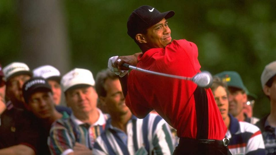 Tiger Woods tees off during the 1997 Masters, where he won his first major title.
