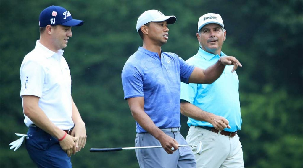 Tiger Woods walks with Fred Couples and Justin Thomas during a practice round at the 2019 Masters.