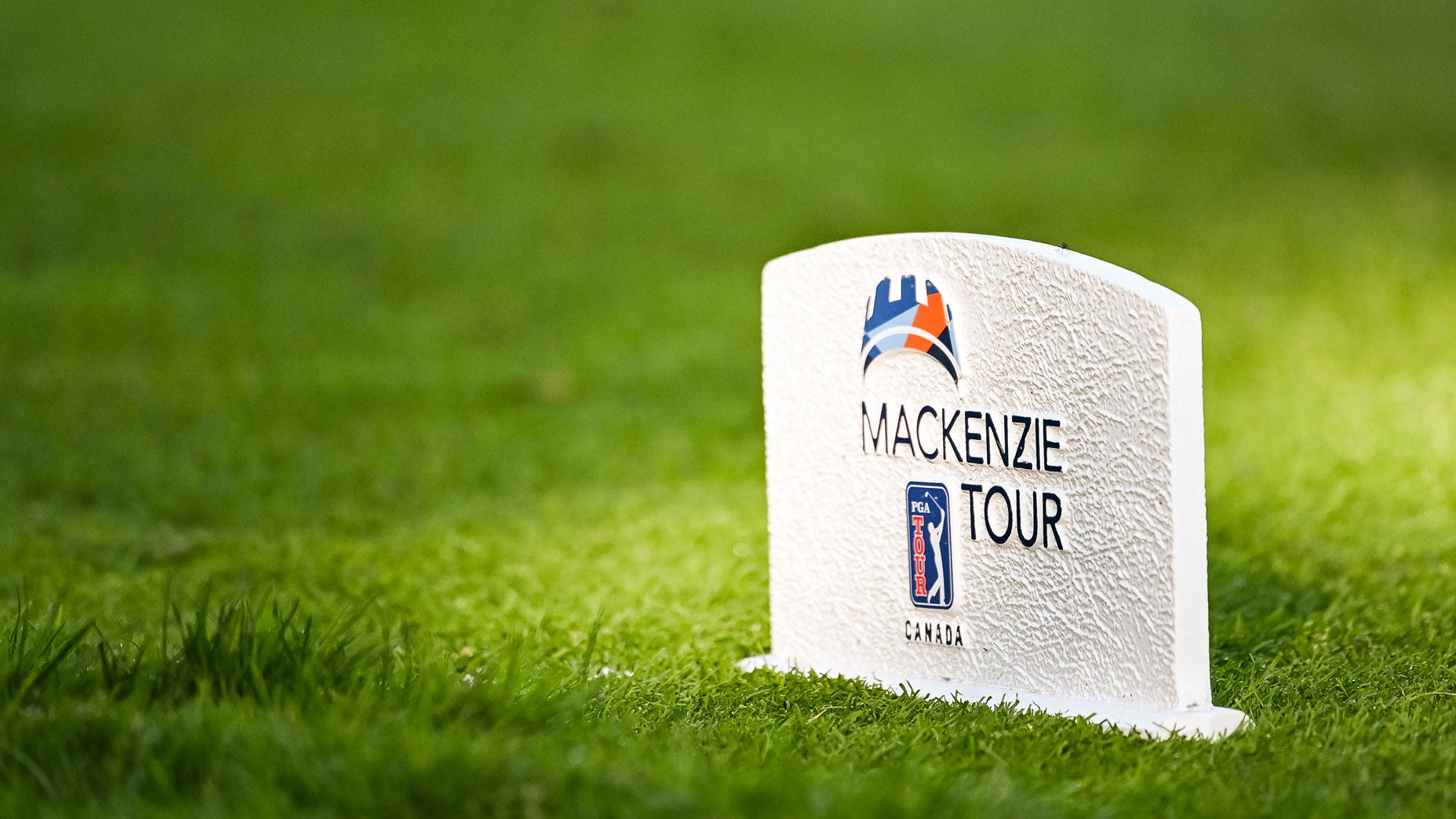A tee marker with the Mackenzie Tour - PGA Tour Canada logo.