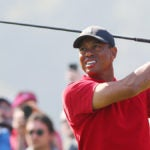 Tiger Woods tees off during an event earlier this year.