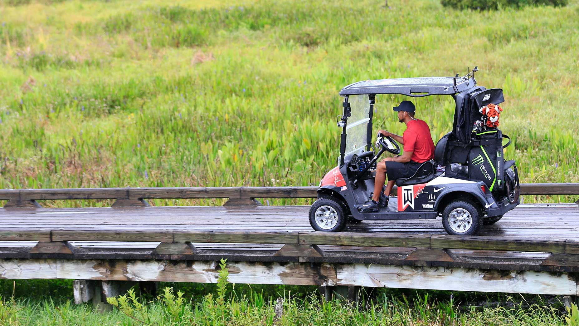 Tiger Woods drives to the 1st tee at Medalist Golf Club.