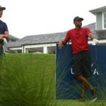 Phil Mickelson and Tiger Woods wait to tee off on the 10th hole at Medalist Golf Club.