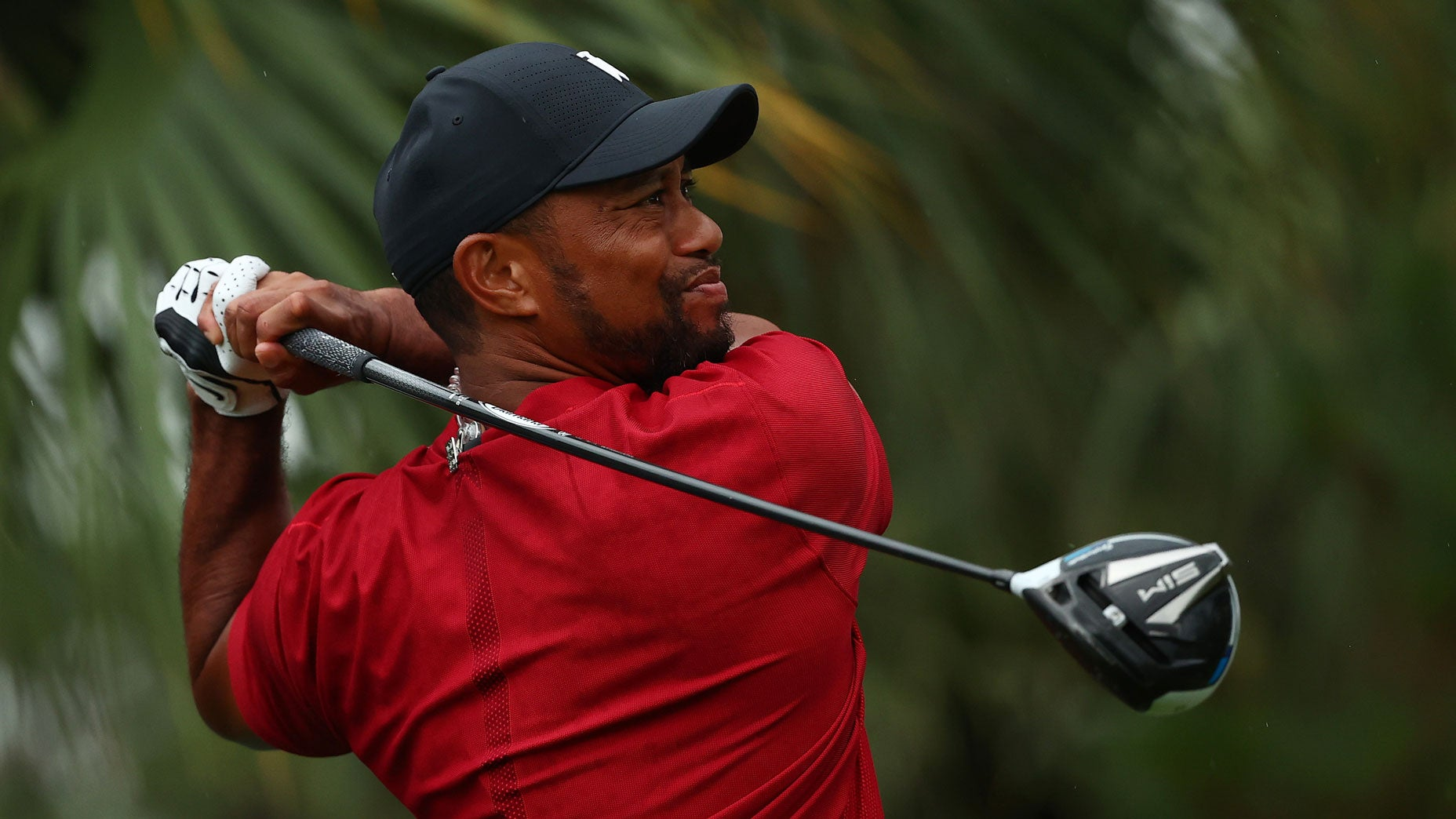 Tiger Woods hits a drive during The Match: Champions for Charity.