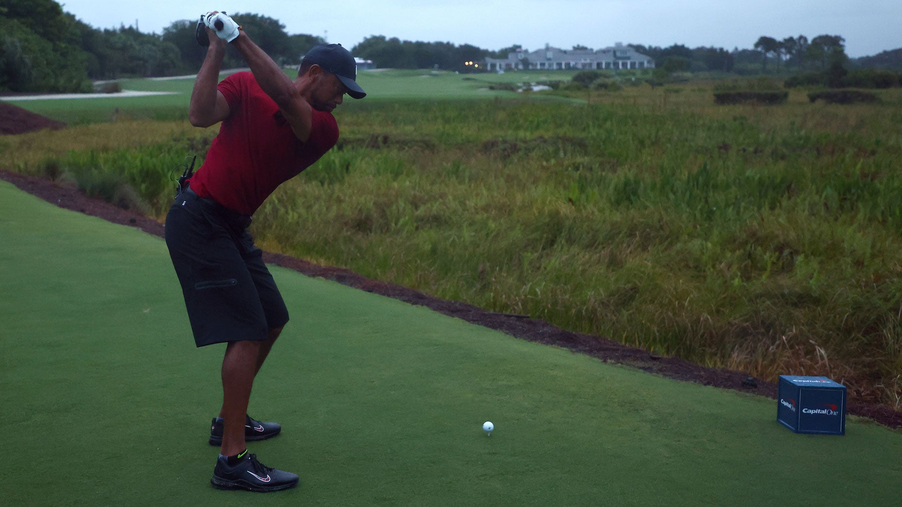 Tiger Woods hits his tee shot on the 18th hole at Medalist Golf Club.