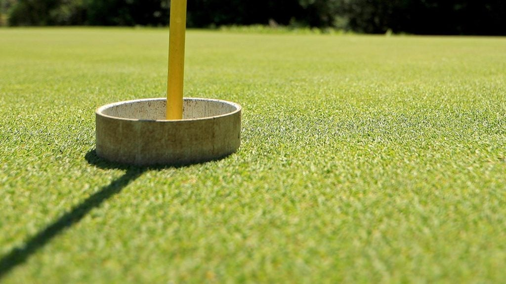 A raised cup on a golf course.