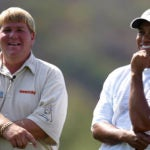 John Daly and Tiger Woods share a laugh in 2005.