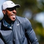 NBA star Andre Iguodala watches golf shot