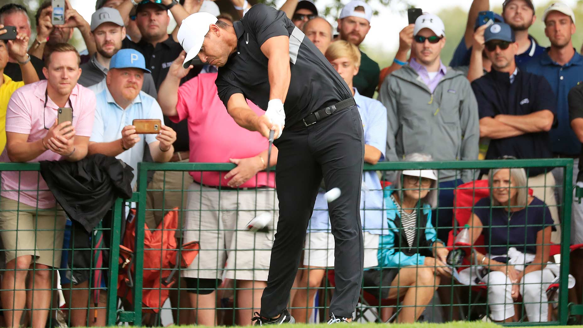 Brooks Koepka hits driver off the tee.