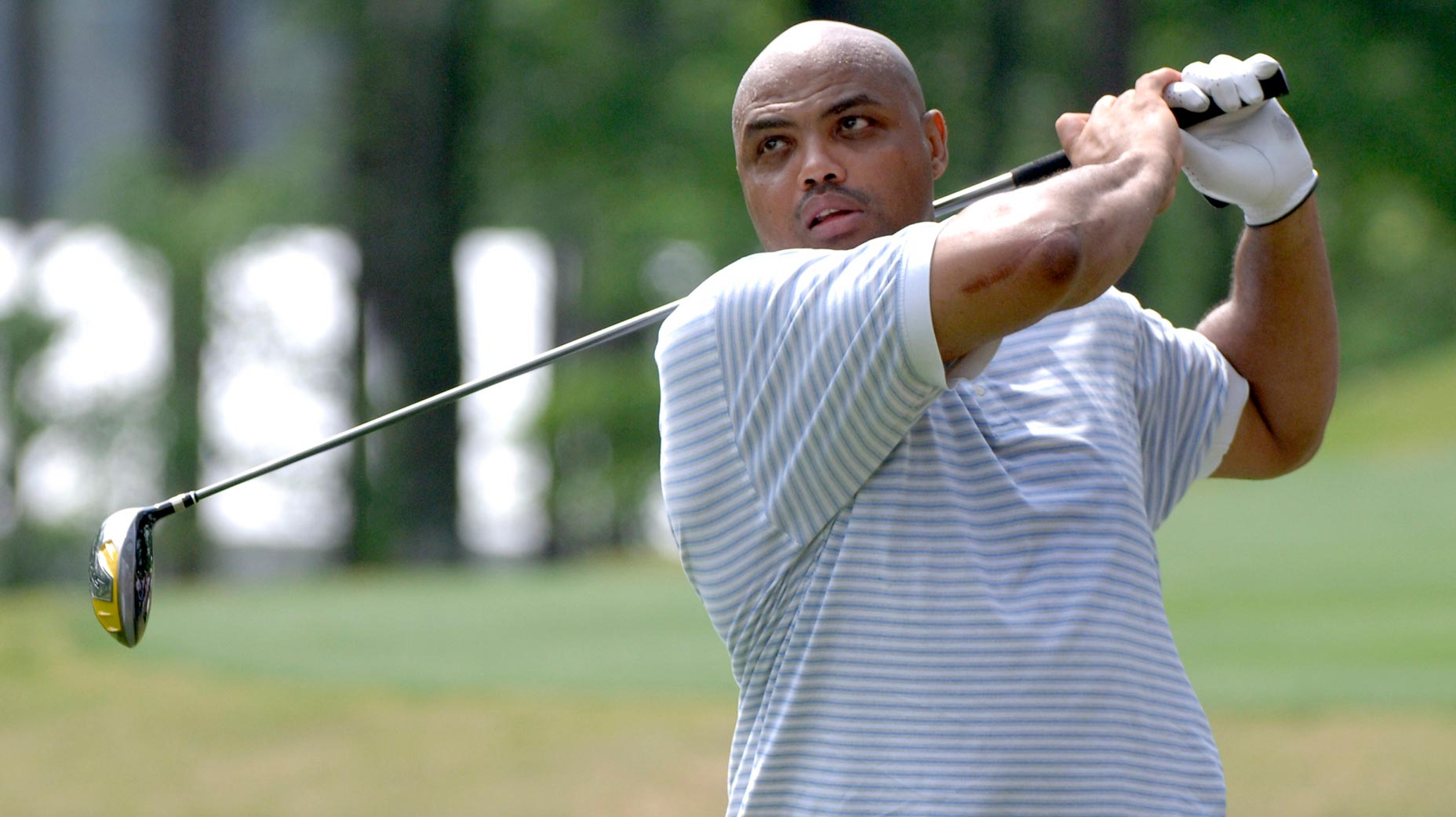 charles barkley swings a golf club