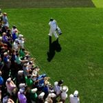 players walk augusta national tee box