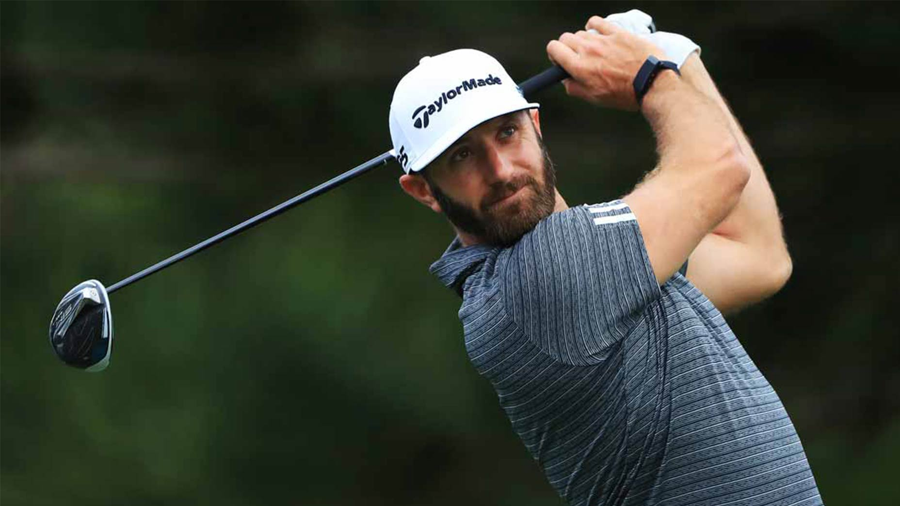 Dustin Johnson hits a drive.