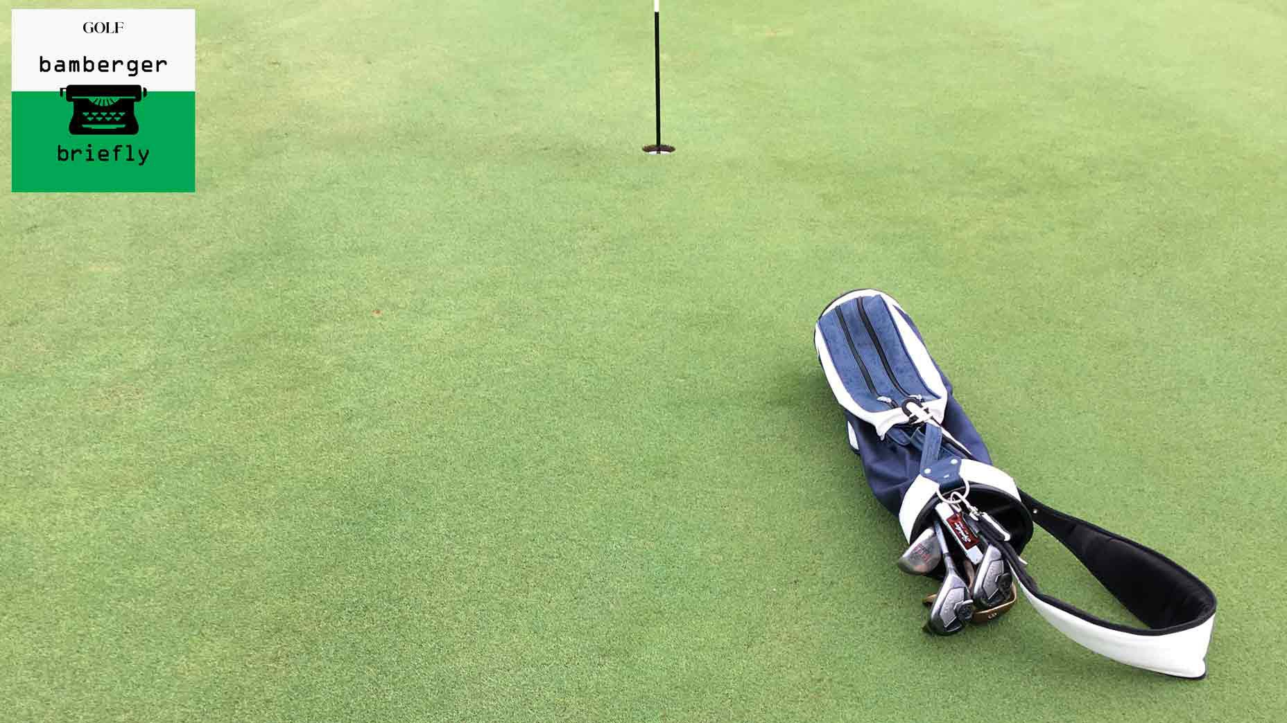 Golf bag lies on Medalist golf green