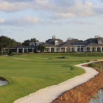 A view of the 18th green and clubhouse at Medalist Golf Club.