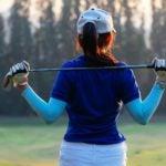 golfer with club on shoulders
