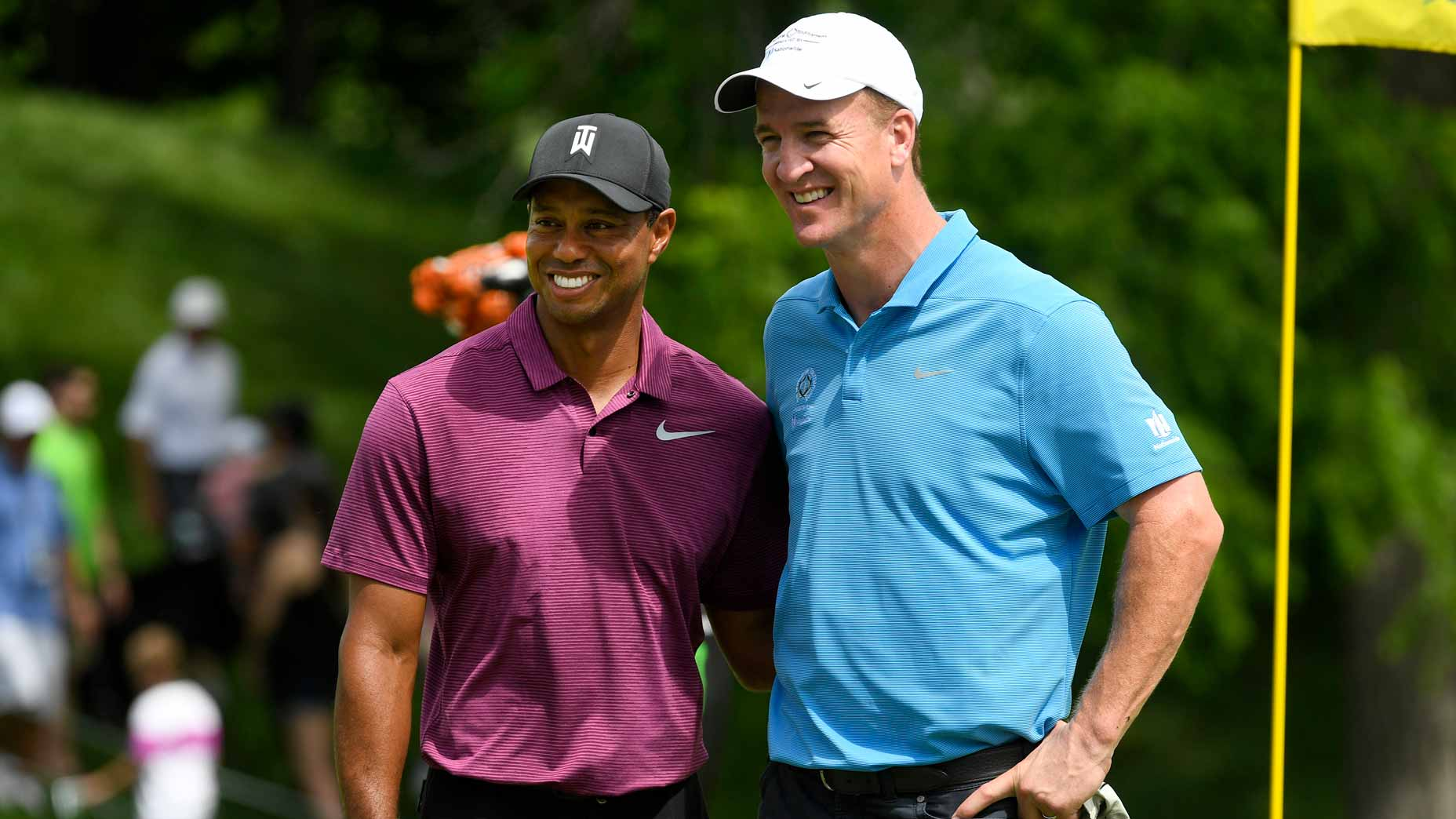 Tiger Woods and Peyton Manning on golf green