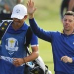 Rory McIlroy and caddie walk at Ryder Cup