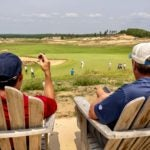 golfers look out over sand valley