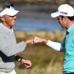 Seth Waugh and golfer fist-bump on golf green