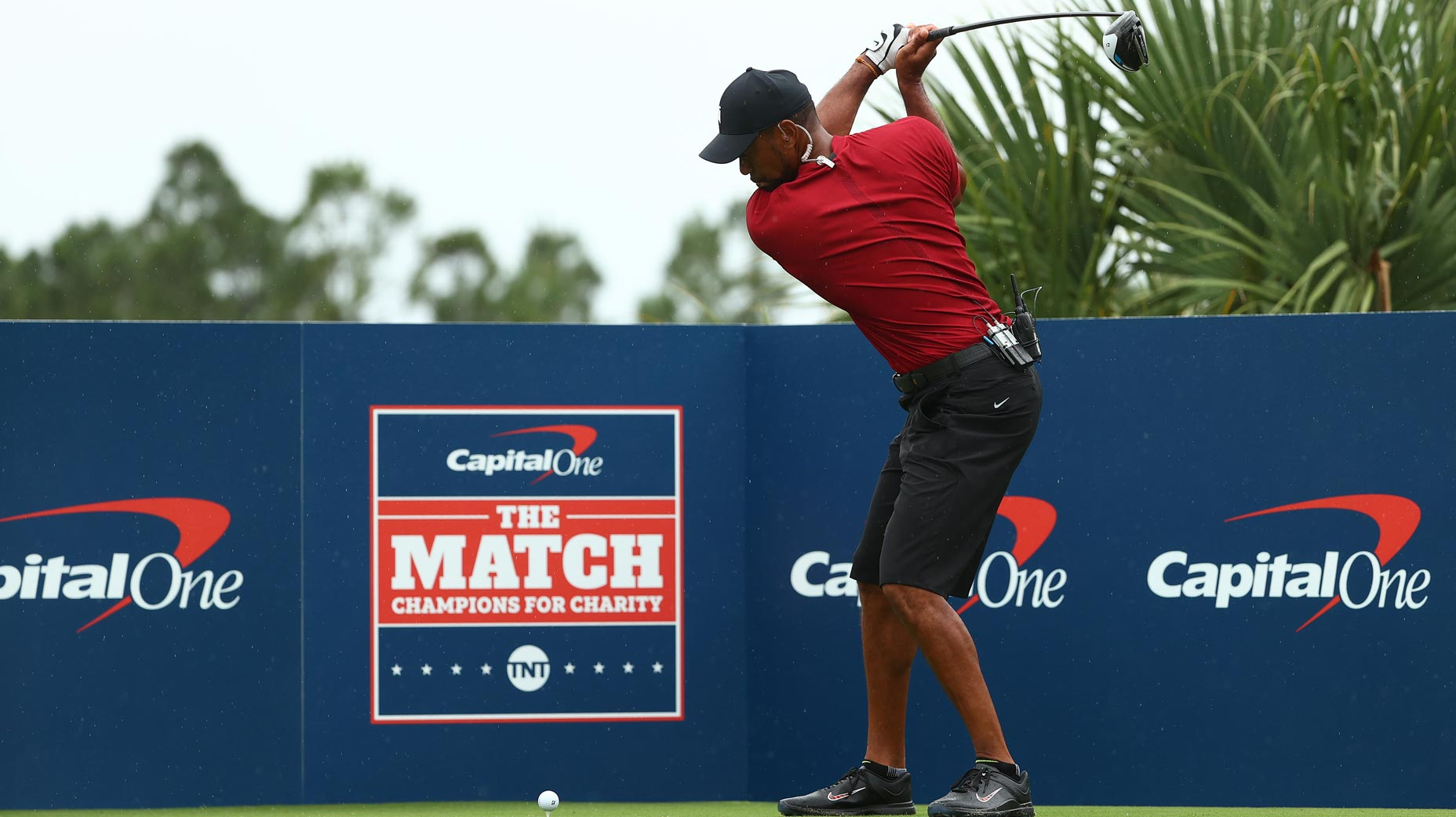 tiger woods hits tee shot during the match ii